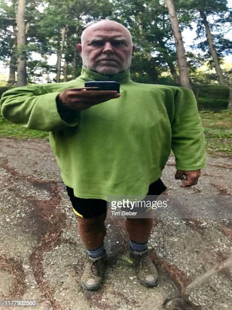 distorted reflection of man taking selfie - fun house stock pictures, royalty-free photos & images