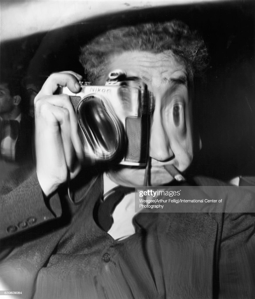 Distorted self-portrait of American photographer Weegee (born Arthur Fellig, 1899 - 1968), mid twentieth century. (Photo by Weegee(Arthur Fellig)/International Center of Photography/Getty Images)