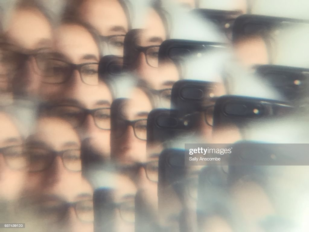 Distorted view of a woman through a prism : Stock Photo