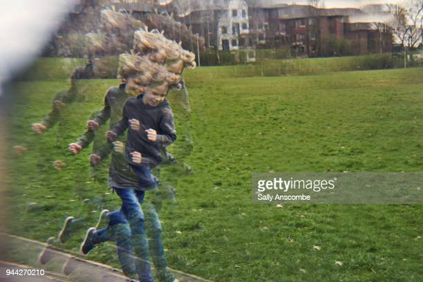 distorted view of child running - distorted image stock pictures, royalty-free photos & images