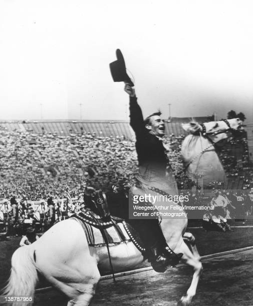 Distortion of American actor Randolph Scott as he rides horse on the field of an outdoor stadium twentieth century Photo by Weegee /International...