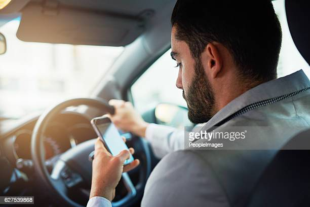 distracted driving can increase the chance of a road accident - driver stock pictures, royalty-free photos & images