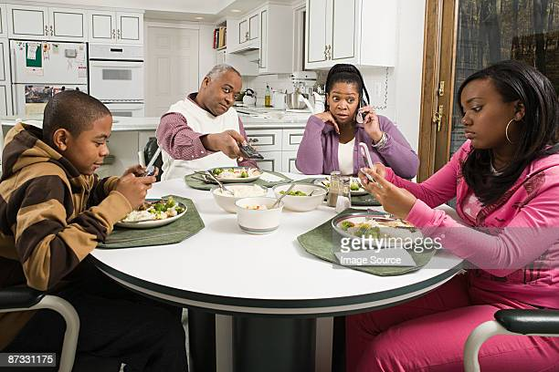 Distracted family at the dinner table