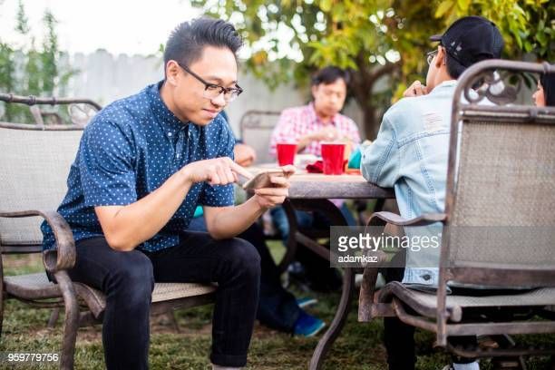 a distracted young boy at the dinner table - filipino family dinner stock pictures, royalty-free photos & images