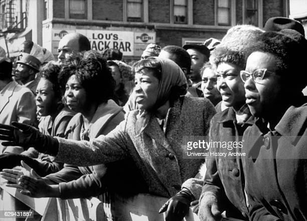 Distraught AfricanAmerican Women Waving Farewell to Slain Leader Malcolm X at Faith Temple New York City USA February 27 1965