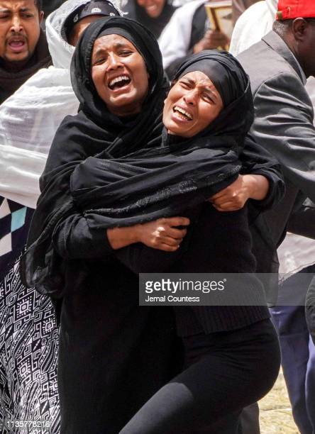 Distraught family members attend a memorial service held for the victims of the Ethiopian Airlines Flight ET302 crash on March 14 2019 in Ejere...