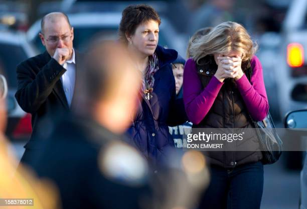 Distraught leave the fire station after hearing news of their loved ones from officials December 14 2012 in Newtown Connecticut A young gunman...
