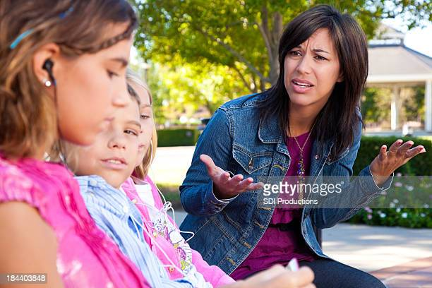 Distraught mother with her kids listening to music