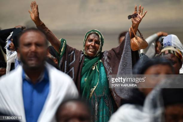 A distraught relative reacts as she arrives at the crash site of the Ethiopian Airlines operated Boeing 737 MAX aircraft at Hama Quntushele village...