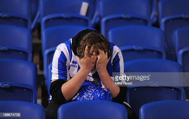 A distraught young Brighton fan at the end of the npower Championship Play Off Semi Final Second Leg between Brighton Hove Albion and Crystal Palace...