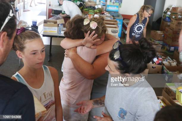 Distress residents gather at the evacuation centre after been told to leave their homes in Wakefield as forest fires continue to burn across the...