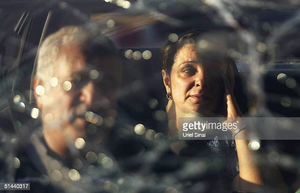 Distressed Israelis are seen throught their broken car windscreen as they return home from Egyypt to the southern Israeli town of Eilat on October 8...