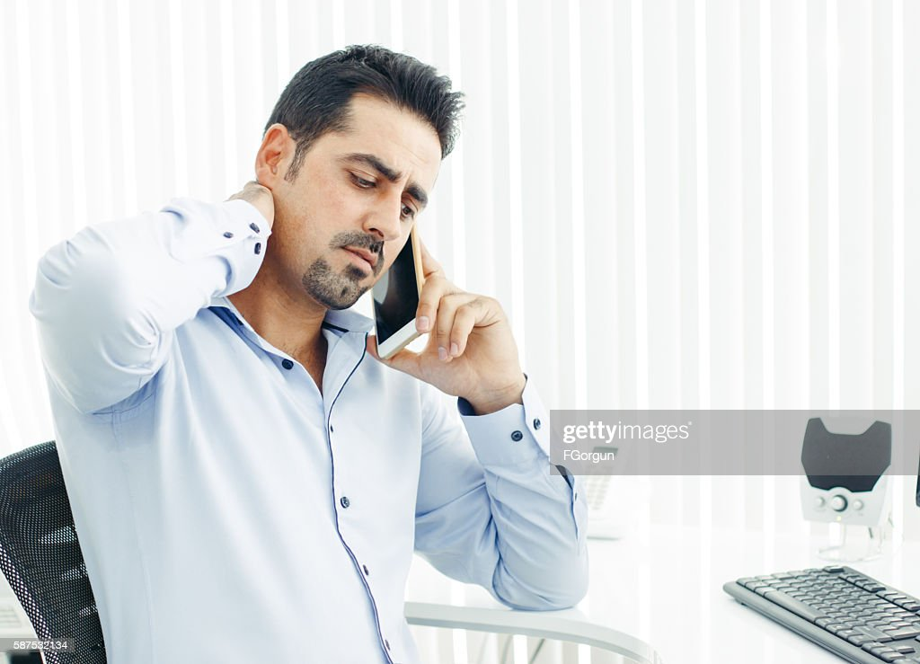 Distressed phone call business man in the office : Stock Photo