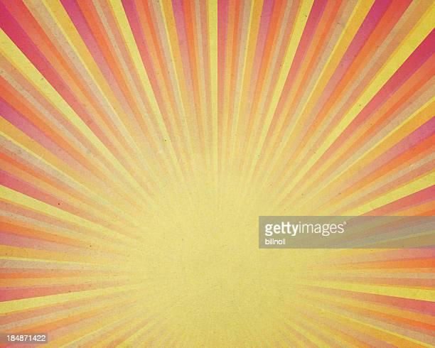 Vieilli papier jaune avec rayons lumineux
