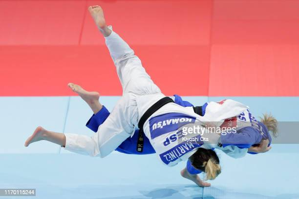 Distria Krasniqi of Kosovo and Laura Martinez Abelenda of Spain compete in the Women's 48kg bronze medal match on day one of the World Judo...