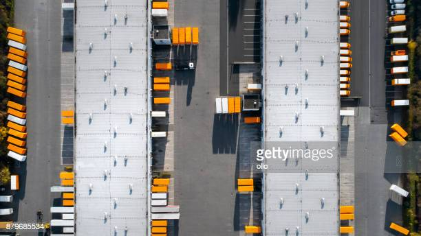 distribution logistics building parking lot - aerial view - heavy industry stock photos and pictures