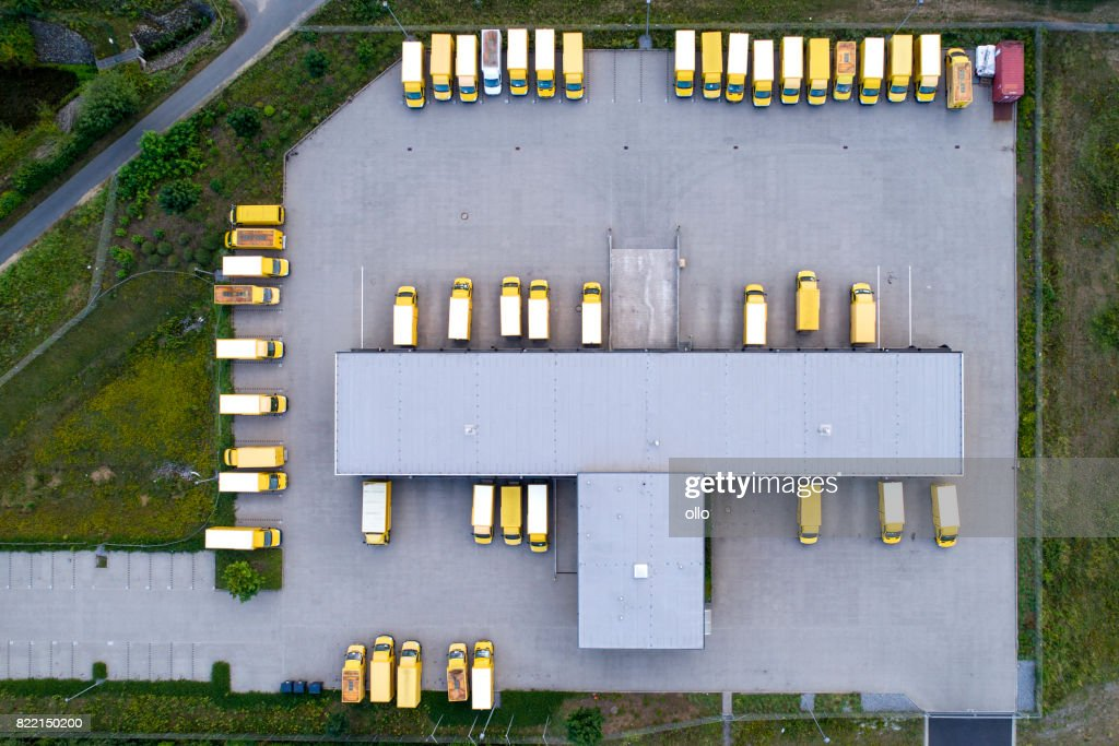 Distribution logistics building parking lot : Stock Photo
