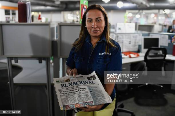 Distribution manager of Venezuelan newspaper El Nacional Ana Marcano poses with the last printed edition of the newspaper at its newsroom in Caracas...