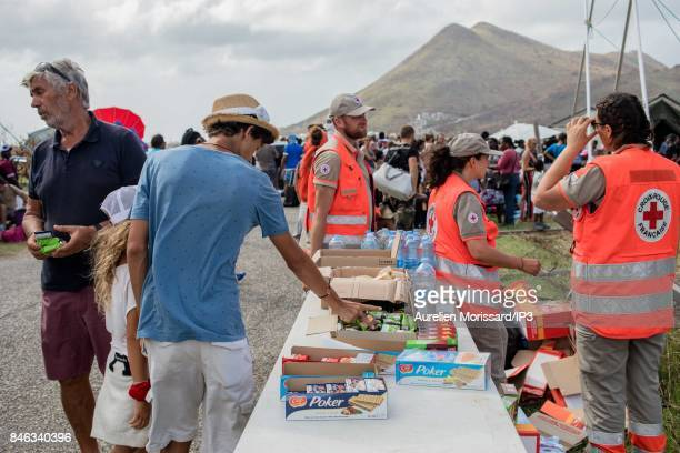 Distribution of food by the Red Cross for civilians evacuated by the French army at the first checkpoint before arriving at Saint Martin airport 7...