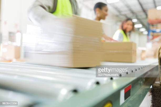 distribution warehouse employees process orders - incidental people stock pictures, royalty-free photos & images