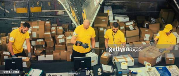 distribution warehouse workers sorting boxes - post structure stock pictures, royalty-free photos & images