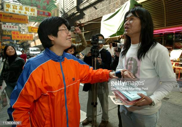 Distric Council elections candidate Choy Soyuk of the Democrate Alliance for the Betterment of Hong Kong greets her competitor 'Long Hair' Leung...