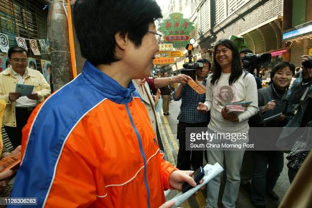 Distric Council elections candidate Choy Soyuk of the Democrate Alliance for the Betterment of Hong Kong greets her competitor quotLong Hairquot...