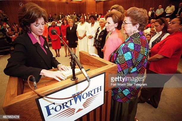 District 9 City Coucilwoman Wendy Davis presents the 11 honorees for the Outstanding Women of Fort Worth March 7 2000 at Fort Worth's City Hall