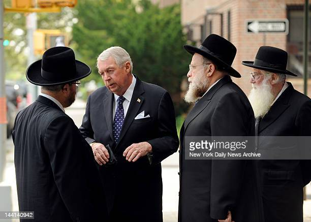 District Attorney Charles Hynes speaking to Ben Barber community liason to the Brookyln Attorney's Office and Rabbi Gershon Tannenbaum They are...
