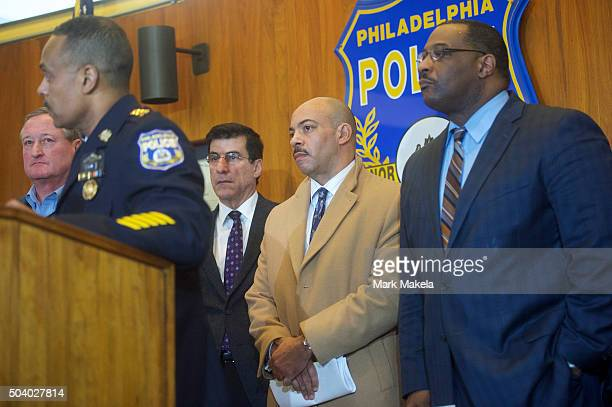 District Attorney of the city of Philadelphia Rufus Seth Williams listens to Philadelphia Police Commissioner Richard Ross address media at a press...