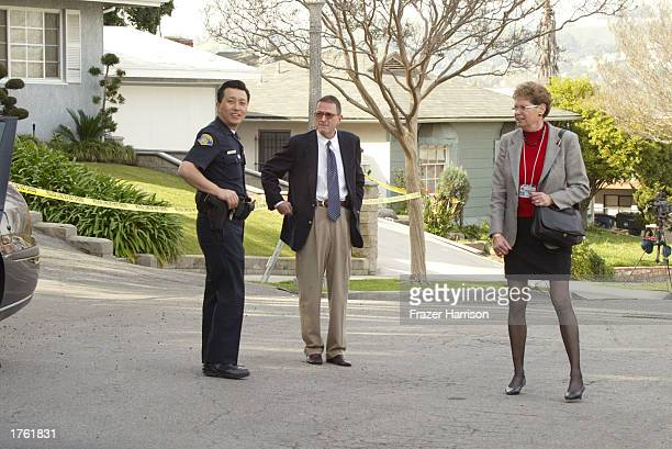 District Attorneys arrive at record producer Phil Spector's home on February 4 2003 in Alhambra California Spector was arrested on February 3 2003...