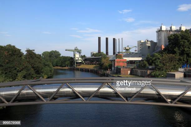 District heating pipeline on a pipeline bridge over the Berlin-Spandau Ship Canal, Moabit power plant at the back, Moabit, Mitte district, Berlin, Germany