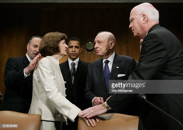 S District Judge Joan Lefkow is welcomed by Sen Charles Schumer Sen Barack Obama Sen Arlen Specter and Sen Patrick Leahy before testifying before the...