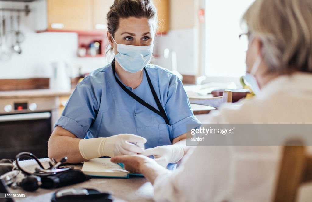 District nurse at home visit : Stock Photo