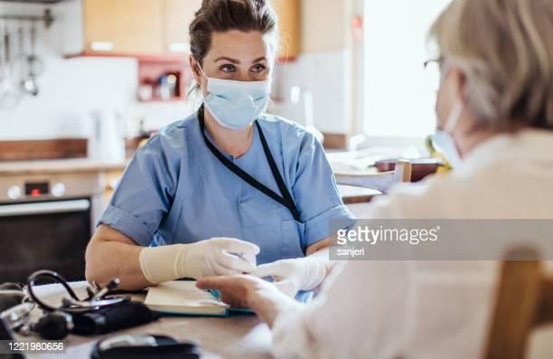 district nurse at home visit - visit stock pictures, royalty-free photos & images