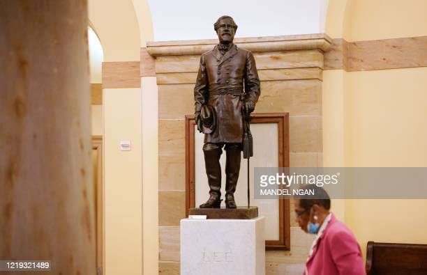 District of Columbia delegate to the House of Representatives, Eleanor Holmes Norton, walks past a statue of Robert E. Lee, commander of the...