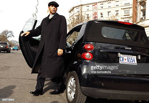 District of Columbia Mayor Adrian Fenty steps out of his Smart Car before holding a news conference with district officials and diplomats outside the...