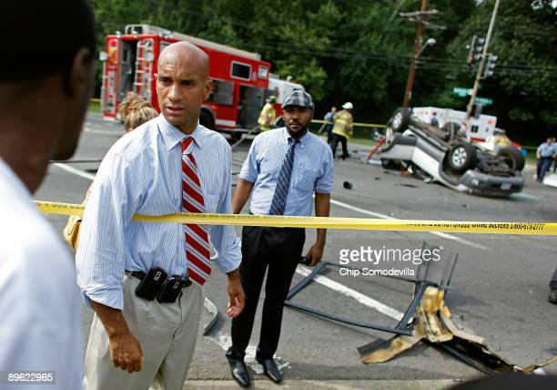 District of Columbia Mayor Adrian Fenty talks with people at the scene of an automobile accident at the intersection of Pennsylvania Avenue SE and...