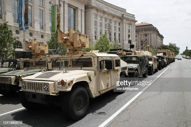 District of Columbia National Guard vehicles are staged in front of the Ronald Reagan Building as the city braces for more demonstrations and...