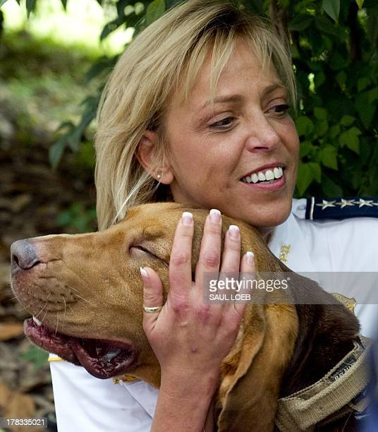 District of Columbia Police Chief Cathy Lanier greets the department's first bloodhound Sam a dog trained to track human scent at Police Headquarters...