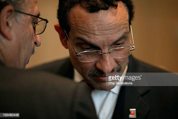 District of Columbia presumptive mayorelect Vincent Gray closely listens to a supporter during a get out the vote campaign event at the First Trinity...