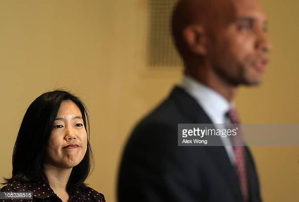 District of Columbia Public Schools Chancellor Michelle Rhee listens as Mayor Adrian Fenty speaks during a news conference October 13 2010 at...