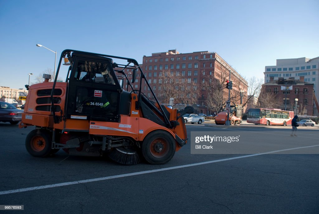 District of Columbia street sweepers pass each other on Massachusetts Ave. and New Jersey Ave., as they clean up trash on Wednesday morning, Jan. 21, 2009, following Barack Obama's Inauguration.