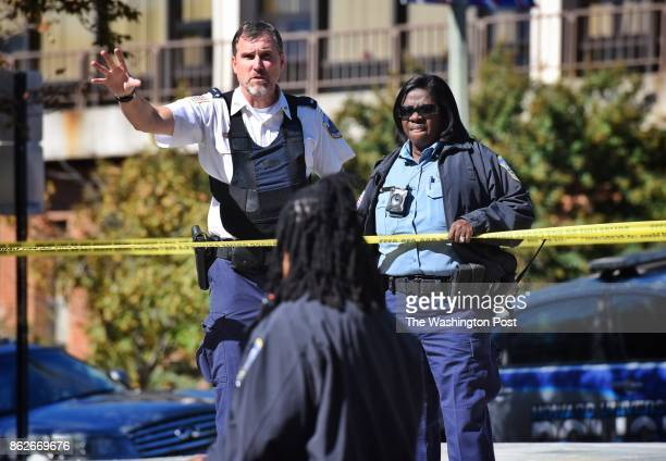 District police officers direct efforts to seal off the campus at Howard University after reports of an active shooter on campus October 17 2017 in...