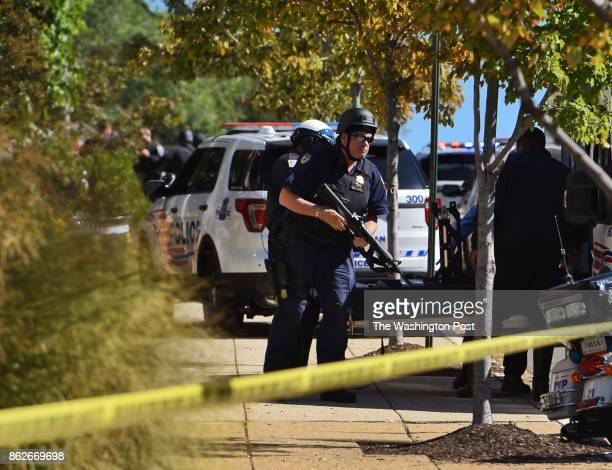 District police officers gear up near Howard University after reports of an active shooter on campus October 17 2017 in Washington DC