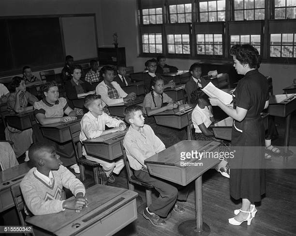 District public schools opened to more than 98000 children White and negro children for the first time were merged in classrooms here Photo shows a...