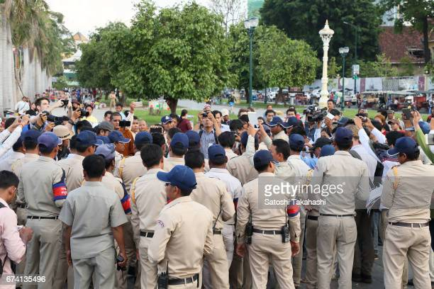 District security guards watch over a commemoration rally to mark the fifth anniversary of slain prominent environmental activist Chut Wutty He was...