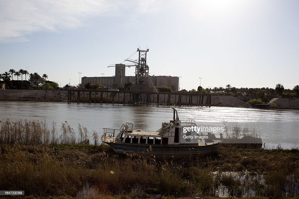A disused boat sits on the edge of the Tigris, March 20, 2013 in Baghdad, Iraq. Ten years after the regime of Saddam Hussein was toppled from power, Baghdad continues to show the scars of the war. In vast areas, infrastructure is fractured and basic services are lacking, however, some areas of the capital are showing promising signs of recovery.