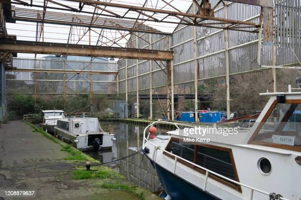 Disused canopy of an old boat yard where goods would once have been taken on and off barges along the Grand Union Canal near Osterly Lock on 25th...