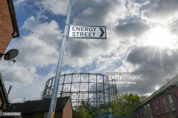 Disused gasometer stands behind a sign for Energy Street near homes on October 11, 2021 in Manchester, England. With the rise in wholesale gas costs,...